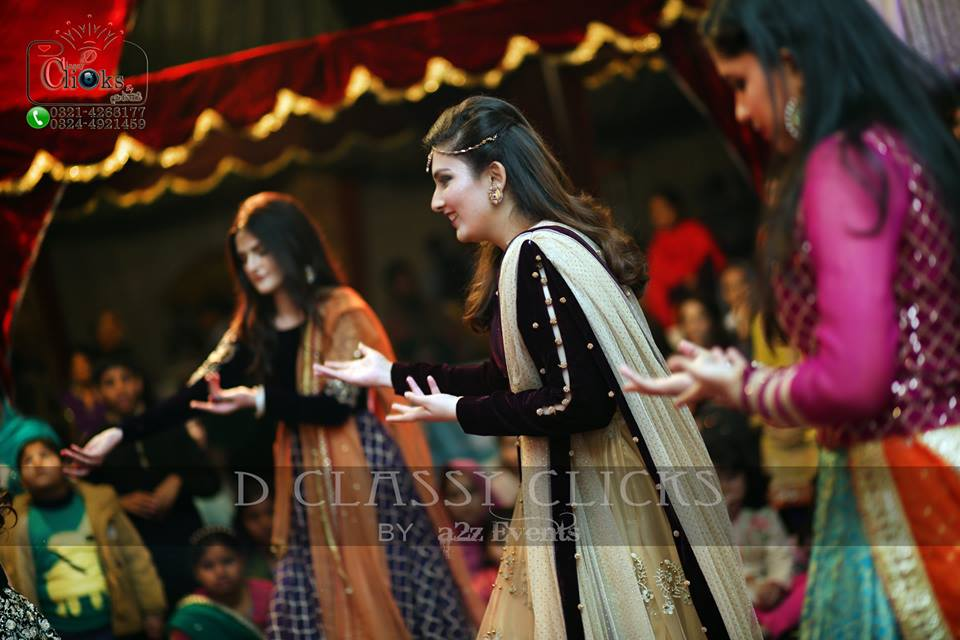 dancing shot, candid, mehndi photography, wedding photographers
